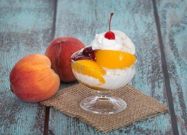 Pesca Melba, la ricetta originale del dessert con frutta e gelato