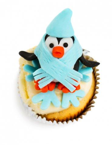 Pinguini in pasta di zucchero, come farli per un cake design simpatico