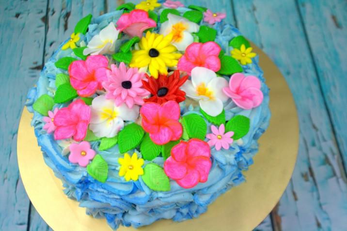 Torte a tema hawaiano con la pasta di zucchero, 5 idee per un cake design esotico